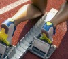 Athletic Feet of Runner Positioned at Starting Block