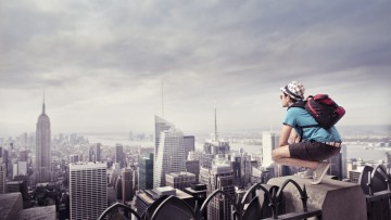 Tourist kneeling on the rooftop